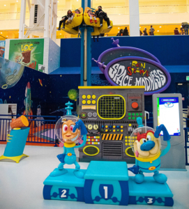 """Ren & Stimpy character sculptures, Captain's Log Podium Sculpture, themed platform, """"Captain's Log"""" Podium Element, """"Space Madness"""" sign, and themed control panel"""