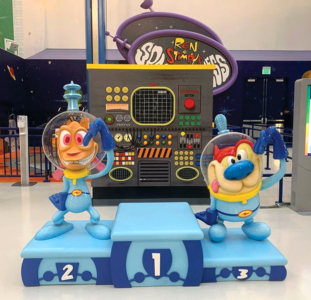 """Ren & Stimpy character sculptures, themed platform, """"Space Madness"""" sign, and themed control panel"""